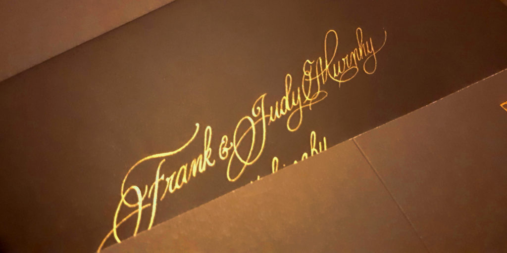 Gold Ink on Black Envelope. Handwritten Wedding Calligraphy.